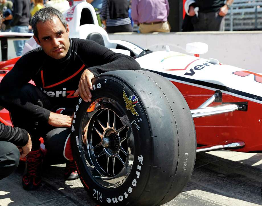 In this photo taken on May 18, 2014, Juan Pablo Montoya, of Colombia, sits next to his car as he waits for his turn to qualify during qualifications for Indianapolis 500 IndyCar auto race at the Indianapolis Motor Speedway in Indianapolis. Montoya needed four races to get comfortable again in an Indy car. His feel has returned just in time for the Indianapolis 500, the race he won in 2000. (AP Photo/Tom Strattman) Photo: Tom Strattman, FRE / FR29600 AP