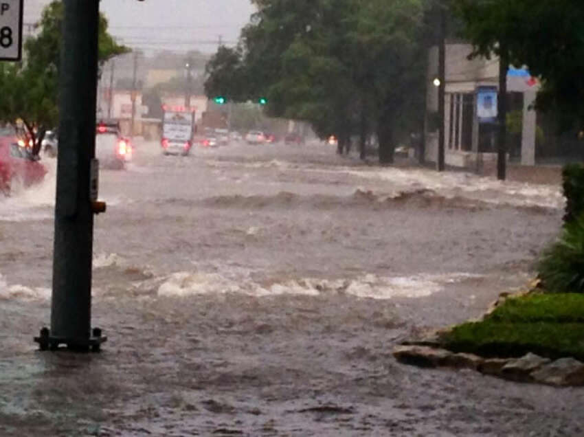 Heavy rains cause flooding on Broadway Wednesday morning, June 25, 2014.
