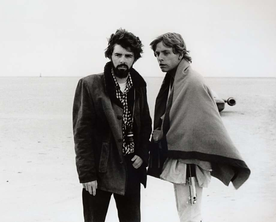 "In this March 1976 publicity photo released by Lucasfilm Ltd. & TM, director George Lucas and actor Mark Hamill, who portrayed young Luke Skywalker, are shown on the salt flats of Tunisia during principal photography of the original ""Star Wars."" Photo: Uncredited, Associated Press"