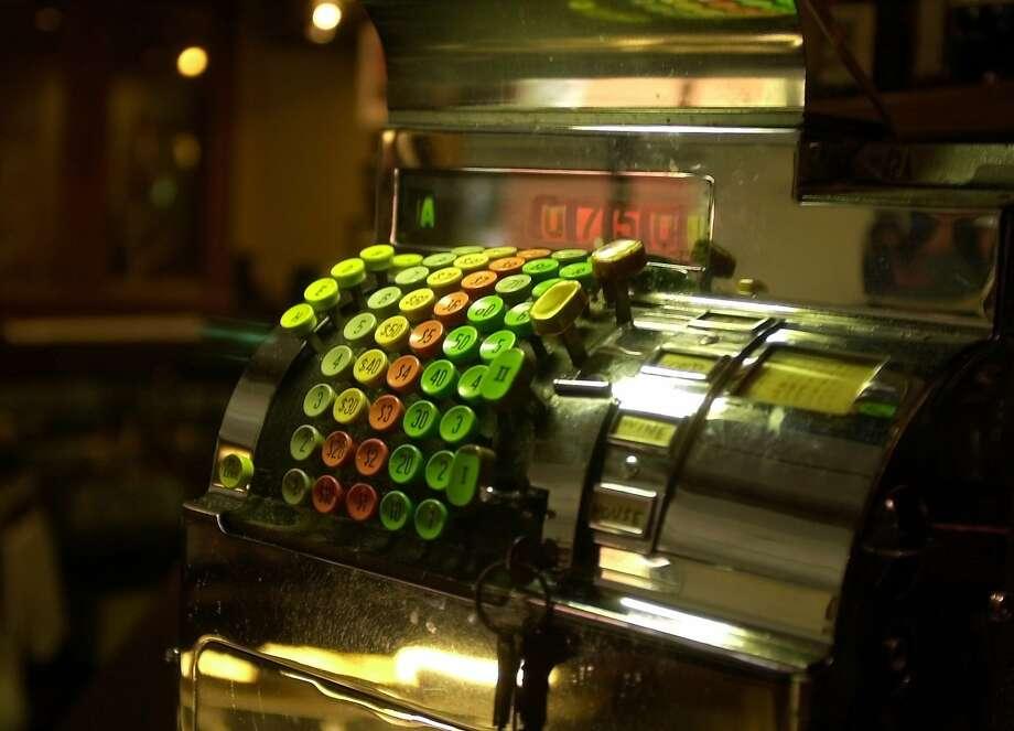 PNFABBROS23B-C-15NOV01-PF-KR Fabbro's. Behind the bar of Fabbro's restaurant  In  Redwood City is  old cash registers  .Photo By Kurt Rogers Photo: Kurt Rogers, SFC