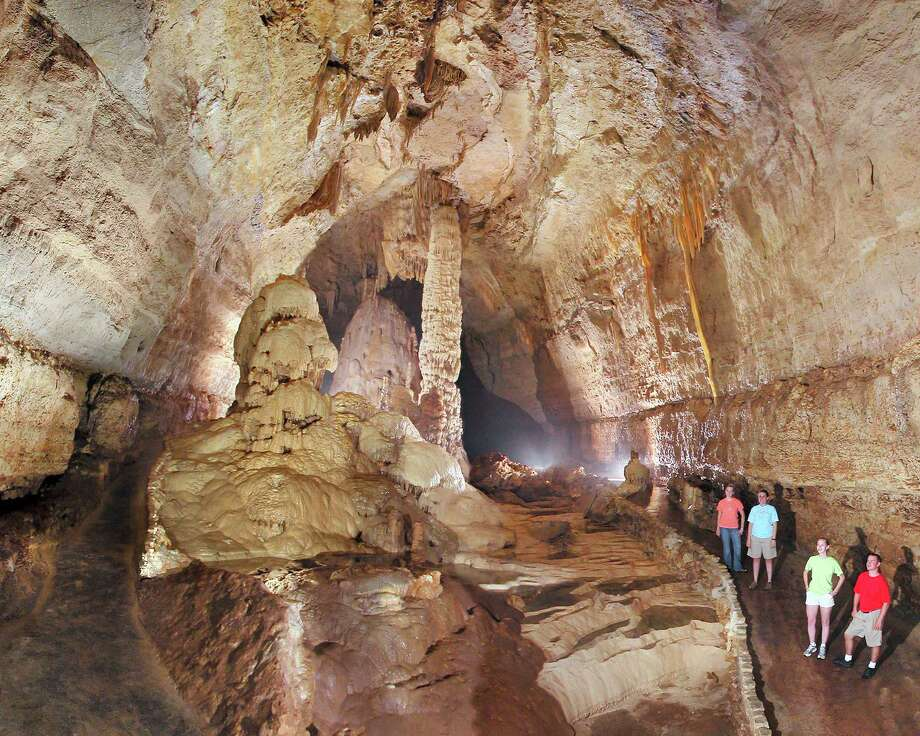Rimstone pools and a flowstone formation called the Bomb Burst grace the entrance to the Castle of the White Giants. / Natural Bridge Caverns