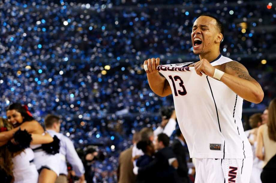 ARLINGTON, TX - APRIL 07:  Shabazz Napier #13 of the Connecticut Huskies celebrates on the court after defeating the Kentucky Wildcats 60-54 in the NCAA Men's Final Four Championship at AT&T Stadium on April 7, 2014 in Arlington, Texas.  (Photo by Ronald Martinez/Getty Images) Photo: Ronald Martinez, Getty Images