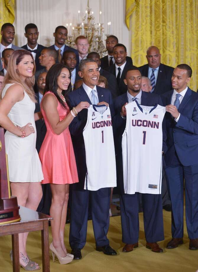 US President Barack Obama (C) poses with Stefanie Dolson (L) and Bria Hartley (2nd L) of the UConn women's Huskies and Ryan Boatright (2nd R) and Shabazz Napier (R) of the UConn men's Huskies during an event in honor of the NCAA 2014 Champions, the UConn Huskies Mens and Womens Basketball teams in the East Room of the White House June 9, 2014 in Washington, DC.  AFP PHOTO/Mandel NGAN        (Photo credit should read MANDEL NGAN/AFP/Getty Images) Photo: MANDEL NGAN, AFP/Getty Images
