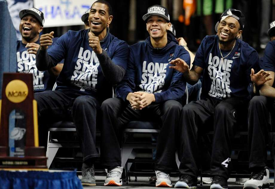 Connecticut coach Kevin Ollie, left, Shabazz Napier, center, and Ryan Boatright, right, smile during a pep rally Tuesday, April 8, 2014, in Storrs, Conn., the day after the team won the NCAA Division I men's basketball title. (AP Photo/Jessica Hill) Photo: Jessica Hill, AP