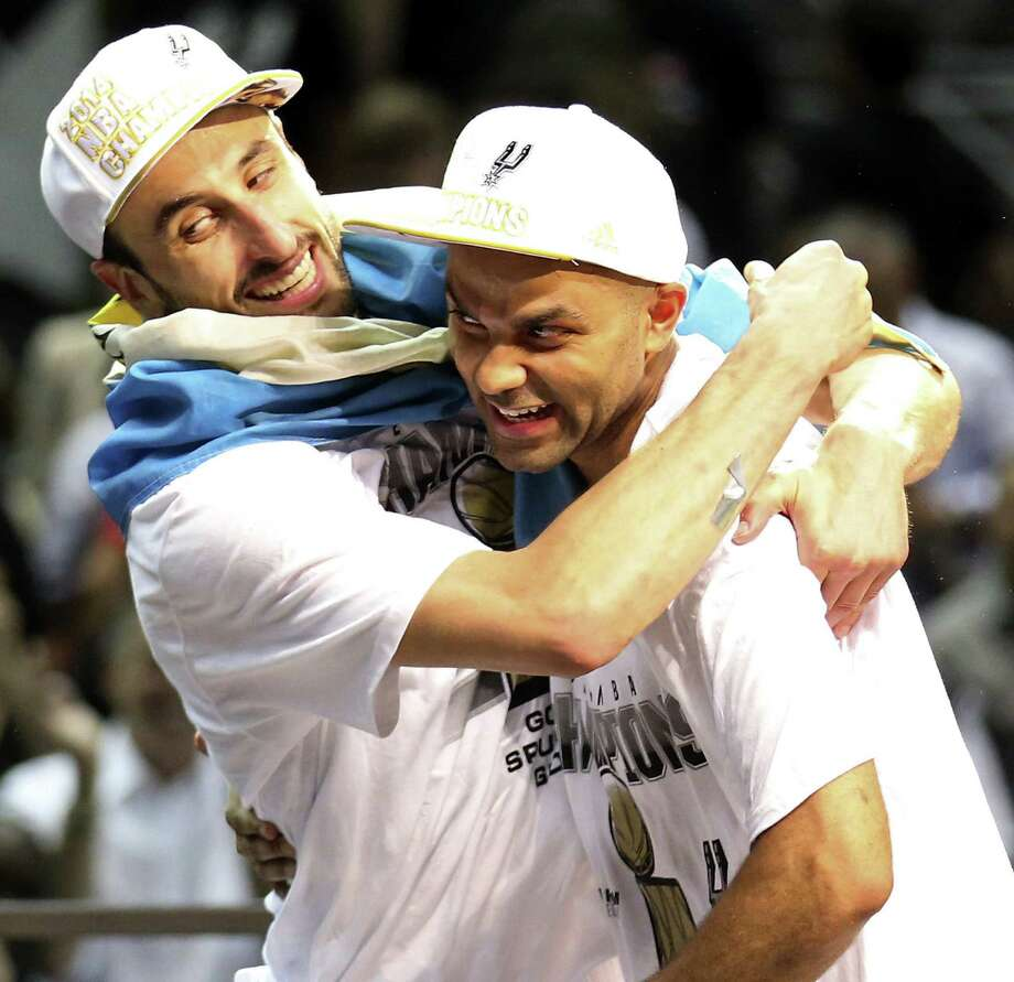 Spurs guards Manu Ginobili and Tony Parker celebrate their fourth NBA championship together. Ginobili looked years younger than 36 in a second-quarter run that turned Game 5 in the Spurs' favor. Photo: Edward A. Ornelas / San Antonio Express-News / © 2014 San Antonio Express-News