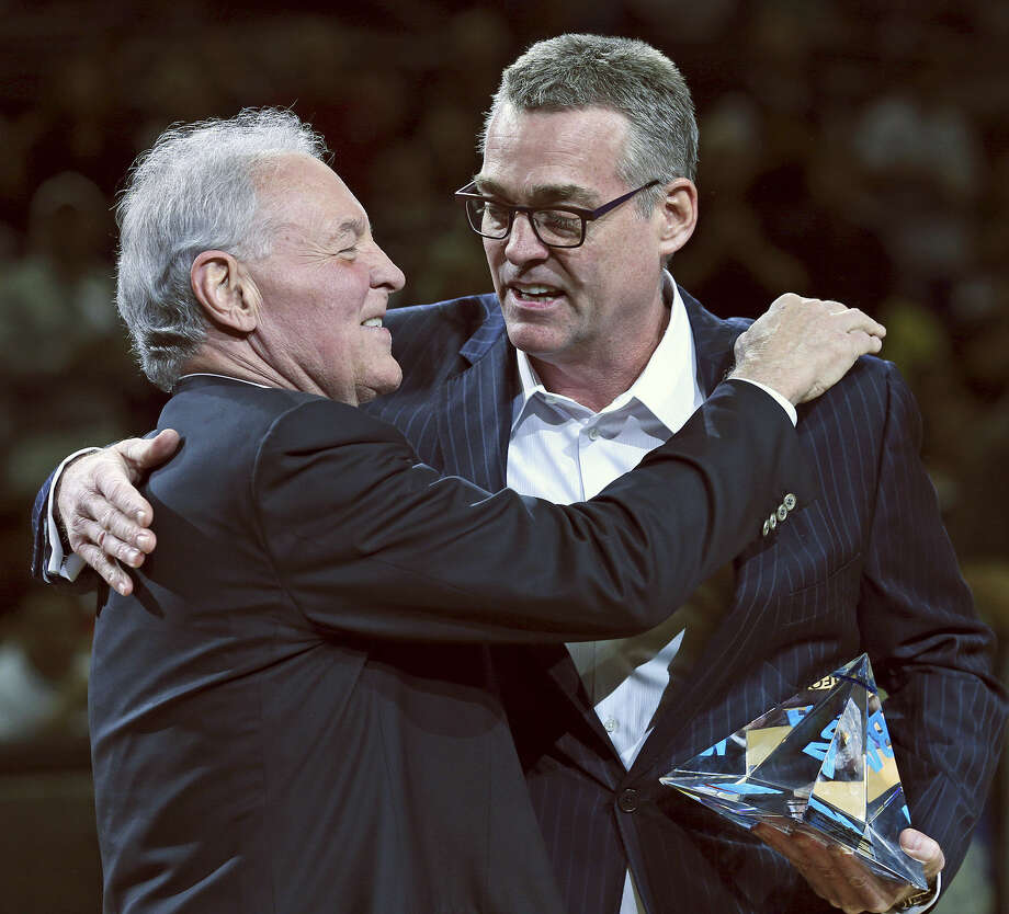 Spurs owner Peter Holt hugs general manager R.C. Buford after giving him his first NBA executive of the year honor before a playoff game against Portland on May 8. Holt and Buford have been the men behind the scenes building the Spurs' dynasty. Photo: Tom Reel / San Antonio Express-News