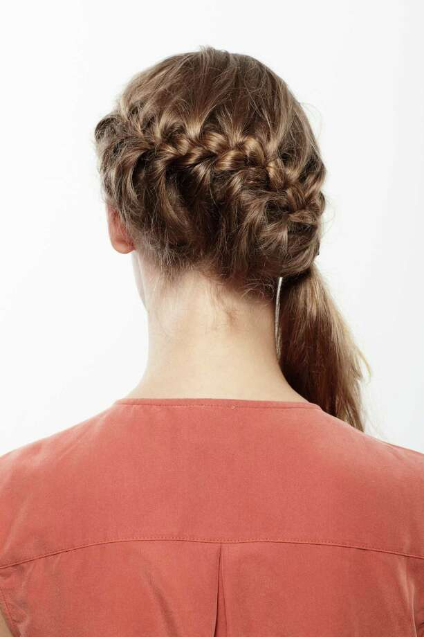 The semi wraparound It looks really fancy, but all it is a french braid into a ponytail. Start from one side of your head and braid until you run out of hair. Then tie it off and there you go.  Photo: Sanne Berg, Getty / (c) Sanne Berg