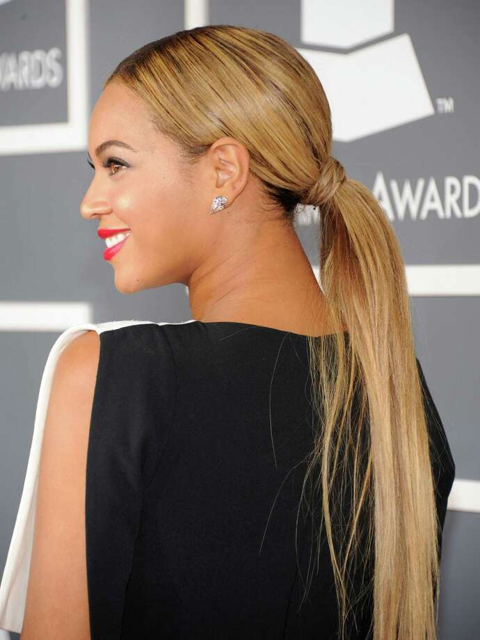 The low ponytailThis is a refined look that is perfect if you are running late but need to look nice. Because it is at the nape of your neck it is easy to get all the hair without having to use a brush. Photo: Kevin Mazur, Getty / 2013 Kevin Mazur