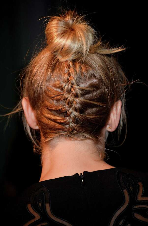 The inverted braid bunSometimes a bun can get a little boring. The great thing about buns is that there is no limit to the amount of variety you can add to them. Don't be afraid to get creative. A braid like this one looks cool and keeps all your hair in one place. Photo: Amanda Edwards, Getty / 2013 Amanda Edwards