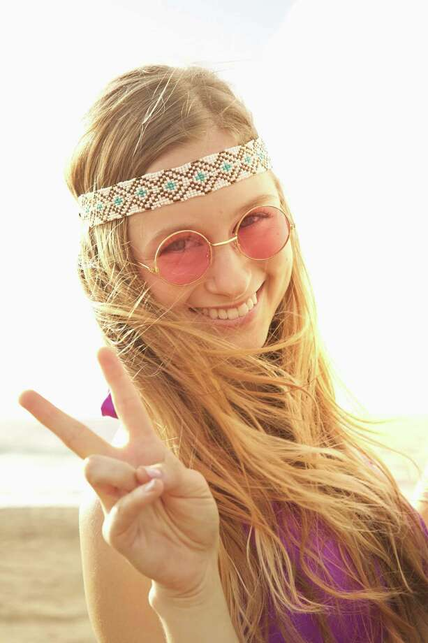 The hippie head bandIf you don't want to put your hair up, a head band is a great way to keep things under wraps. Photo: Colin Anderson, Getty / Blend Images