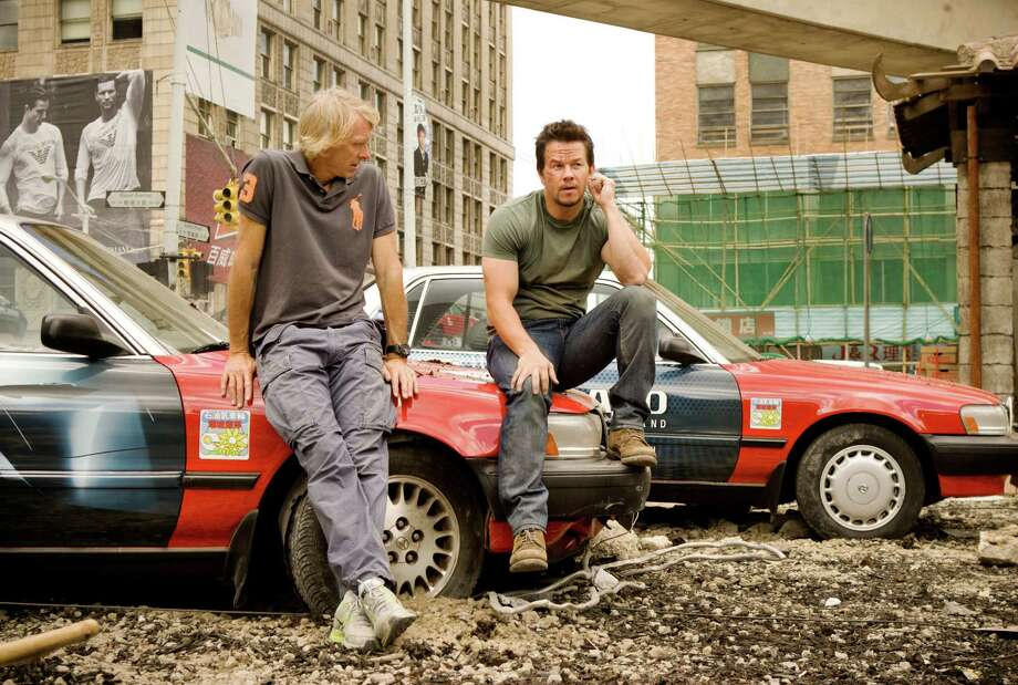 "This image released by Paramount Pictures shows director Michael Bay, left, with Mark Wahlberg on the set of ""Transformers: Age of Extinction."" (AP Photo/Paramount Pictures, Andrew Cooper) ORG XMIT: NYET133 Photo: Andrew Cooper / Paramount Pictures"