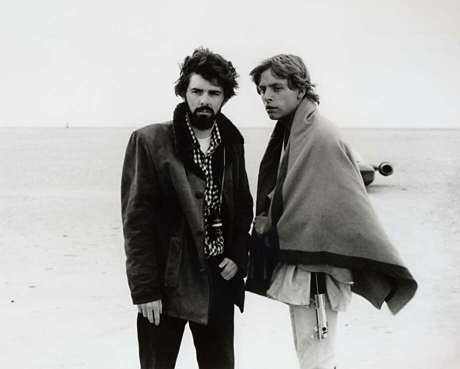 """""""Star Wars"""" director George Lucas and actor Mark Hamill, who portrayed Luke Skywalker, on the salt flats of Tunisia during principal photography of """"Episode IV."""" Photo: Uncredited, Associated Press"""