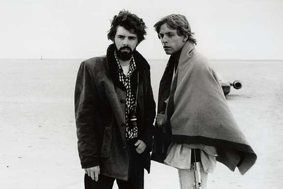 "FILE - In this March 1976 publicity photo released by Lucasfilm Ltd. & TM, director, George Lucas, and actor, Mark Hamill, who portrays young Luke Skywalker, are shown on the salt flats of Tunisia during principal photography of the original ""Star Wars.""  Lucas has selected Chicago to house his much anticipated museum of art and movie memorabilia, a spokesman for the mayor's office said Tuesday, June 24, 2014. Bill McCaffrey, a spokesman for Mayor Rahm Emanuel, confirmed that Lucas had selected Chicago but did not immediately have any details. (AP Photo/Lucasfilm Ltd. & TM, file)"