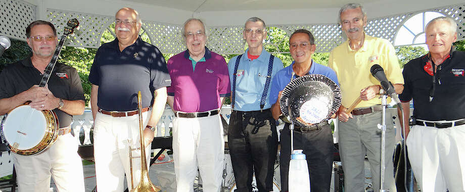 Galvanized Jazz Band musicians take a break from a concert in Fairfield, Conn., in 2013. They will return to the town's gazebo for a free outdoor concert on Wednesday, July 9, 2014. Pictured are, from left, Bob Price, Neil DeFeo, Bill Sinclair, Art Hovey, Fred Vigorito, Bob Bequillard and Russ Whitman. Photo: Mike Lauterborn, File Photo / Fairfield Citizen contributed