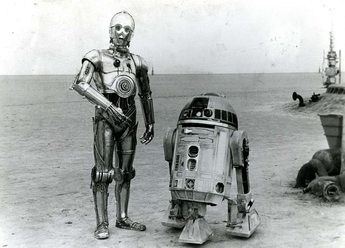 Robots R2-D2 and C-3PO in the Tatooine desert in