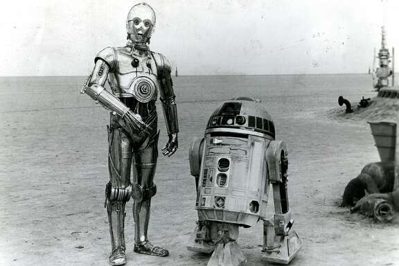 "Robots R2-D2 and C-3PO in the Tatooine desert in ""Star Wars."""
