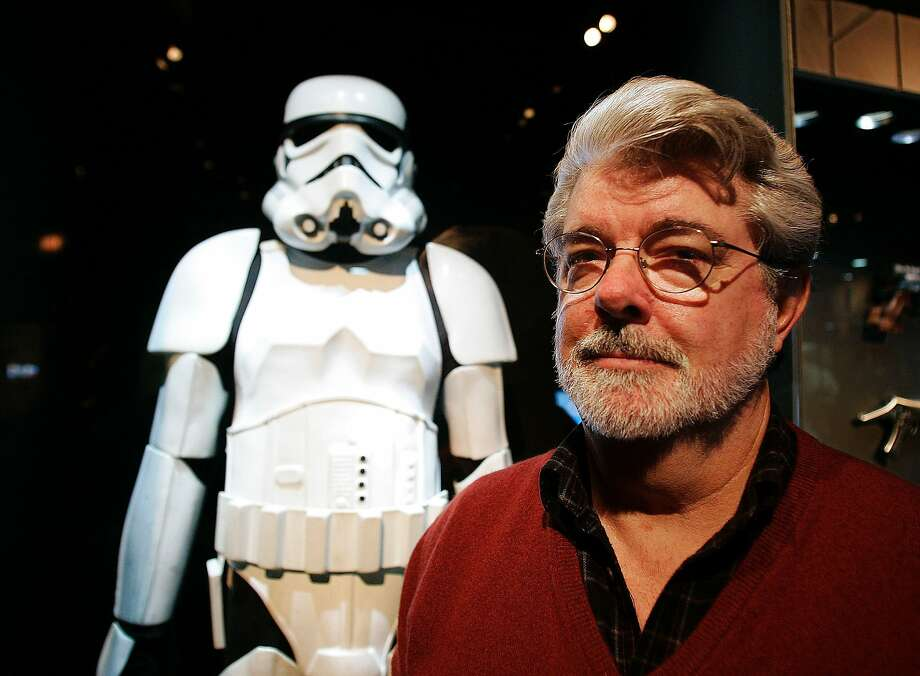 "Filmmaker George Lucas pauses in front of a Stormtrooper exhibit at the Museum of Science in Boston, Saturday, Oct. 22, 2005, prior to the opening of ""Star Wars: Where Science Meets Imagination,"" exhibit in 2005. Photo: Winslow Townson, AP"