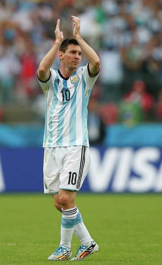Argentina's Lionel Messi acknowledges the spectators as he is substituted during the group F World Cup soccer match between Nigeria and Argentina at the Estadio Beira-Rio in Porto Alegre, Brazil, Wednesday, June 25, 2014. (AP Photo/Victor R. Caivano) Photo: Victor R. Caivano, Associated Press / AP