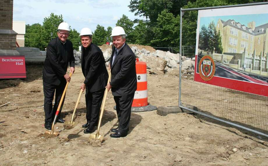 Officials dig ceremonial, gold-painted shovels into the earth to mark groundbreaking for Fairfield Prep's $8.5 million addition. From left are the Rev. Jeffrey von Arx, Fairfield University president; the Rev. John Hanwell,  Fairfield Prep president; and Dr. Bob Russo, chairman of Prep's board of trustees. Photo: Fairfield Citizen/Contributed / Fairfield Citizen
