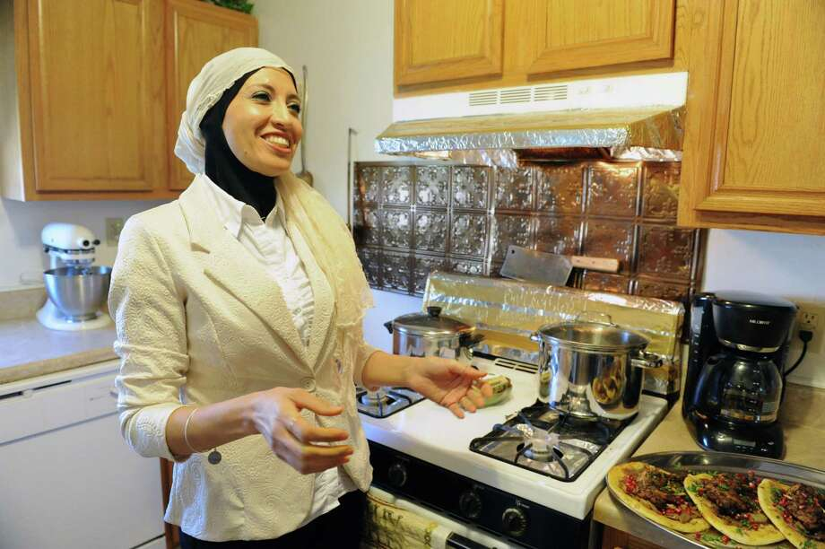 Sahar Darwin with her traditional dish Musakhan, Palestinian sumac chicken with sauteed onions, on Friday June 20, 2014 in Colonie, N.Y.  (Michael P. Farrell/Times Union) Photo: Michael P. Farrell / 00027405A