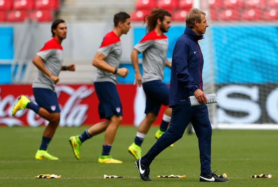 Head coach Jurgen Klinsmann of the United States walks the pitch during the US Men's National Team training at Arena Pernambuco on June 25, 2014 in Recife, Brazil. Photo: Kevin C. Cox, Getty Images