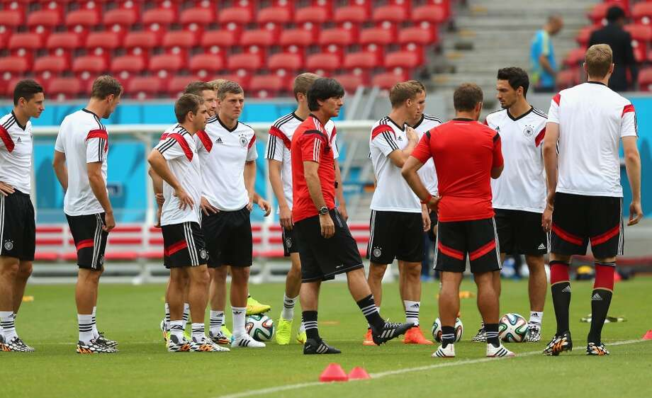 Joachim Loew (C), head coach of Germany gives instructions to the team during the Germany training session ahead of the 2014 FIFA World Cup Group G match between USA and Germany held at Arena Pernambuco on June 25, 2014 in Recife, Brazil. Photo: Martin Rose, Getty Images