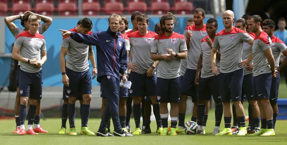 United States' head coach Jurgen Klinsmann, center left, instructs his players during a training session in Recife, Brazil, Wednesday, June 25, 2014. The U.S. will play Germany in group G of the 2014 soccer World Cup on June 26. Photo: Julio Cortez, Associated Press