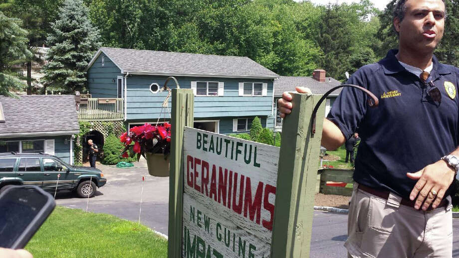 Police Lt. James Perez talks to reporters outside 3840 Black Rock Turnpike where a man was forcibly disarmed after shooting an opossum in his garage Wednesday afternoon, and tenants at the property believed he also was threatening to shoot their pet. Photo: Genevieve Reilly / Fairfield Citizen