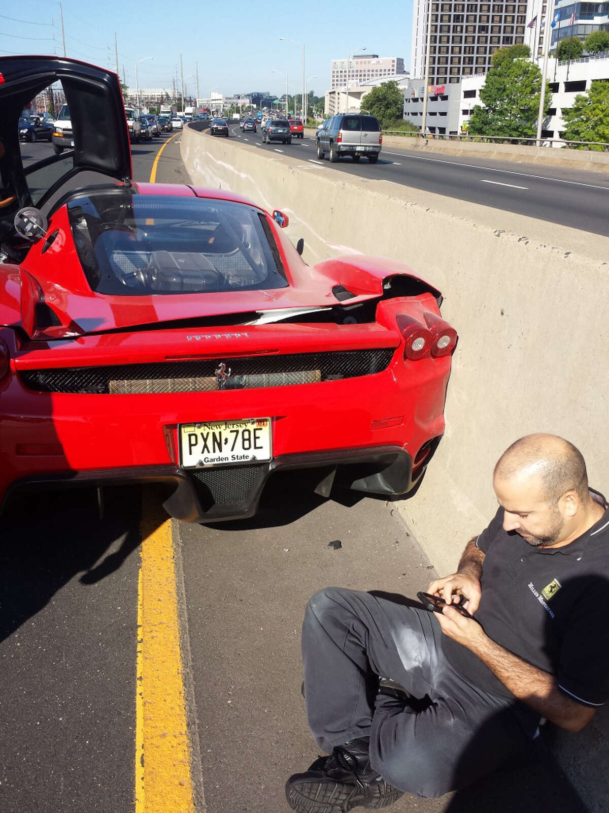 A New York man driving a rare Ferrari Enzo owned by a Cuban-born multi-millionaire lost control of the $600,000-plus car while getting onto Interstate-95 at Exit 7 in Stamford Monday, June 23, 2014.