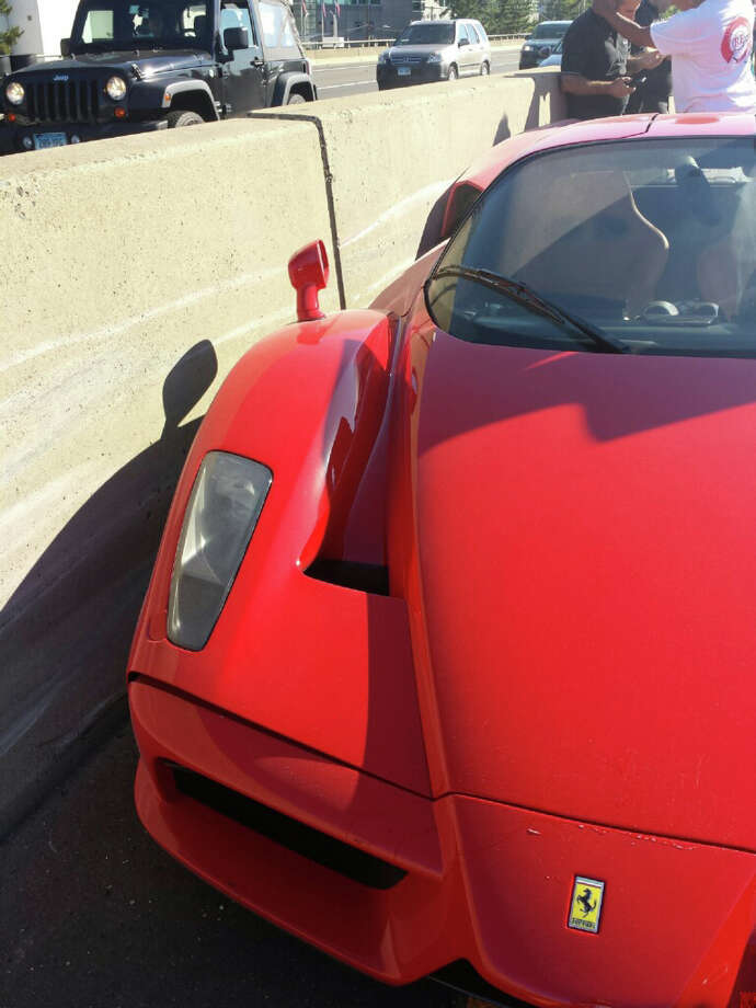 A New York man driving a rare Ferrari Enzo owned by a Cuban-born multi-millionaire lost control of the $600,000-plus car while getting onto Interstate-95 at Exit 7 in Stamford Monday, June 23, 2014. Photo: John Michael Hoda