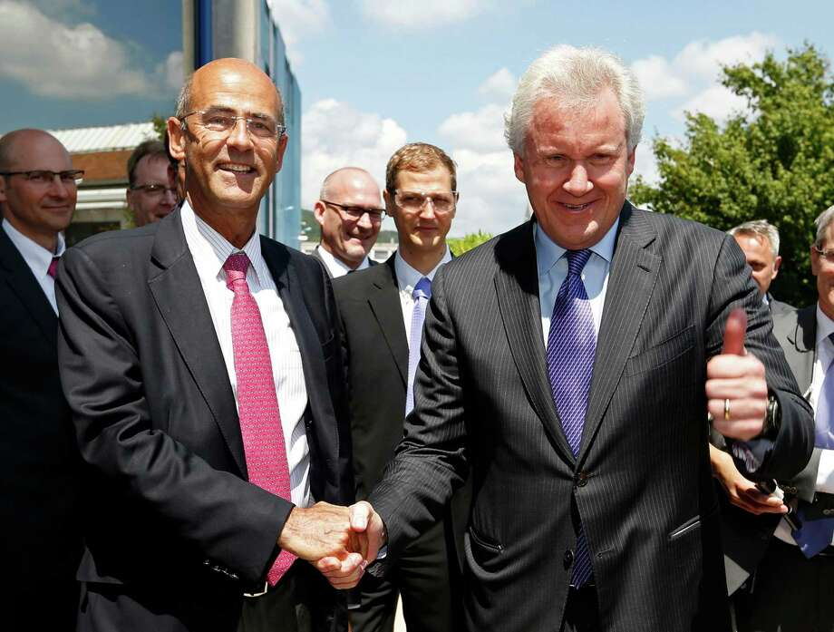 General Electric Chairman and CEO Jeffrey Immelt (R) and Alstom Chairman and Chief Executive Patrick Kron pose for a picture at their arrival at the turbines production unit of the Alstom plant in Belfort, June 24, 2014. REUTERS/Vincent Kessler Photo: VINCENT KESSLER, REUTERS / Connecticut Post Contributed