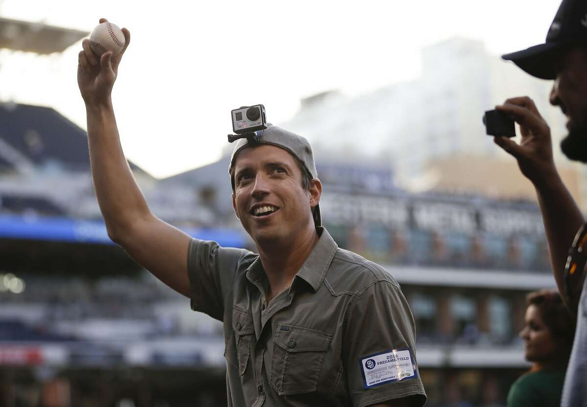 In this June 6, 2014 photo, GoPro founder and CEO Nick Woodman wears a GoPro camera on his head before throwing out a ceremonial first pitch before a baseball game between the San Diego Padres and the Washington Nationals, in San Diego. GoPro, the maker of wearable sports cameras, loved by mountain climbers, divers, surfers and other extreme sports fans, is expected to start selling its shares for the first time and begin trading on the Nasdaq stock market on Thursday, June 26, 2014. (AP Photo/Gregory Bull)