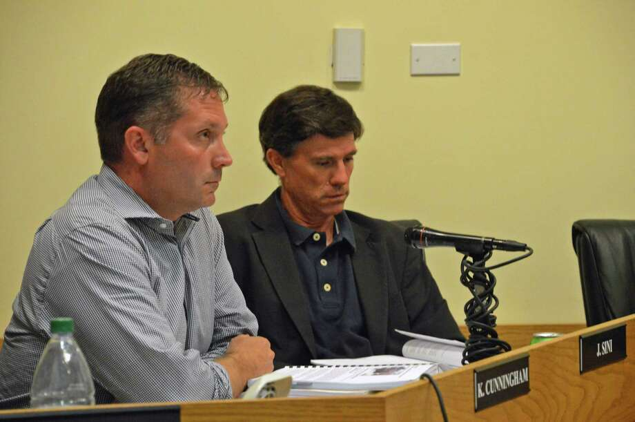 Darien Planning and Zoning commissioners John Sini, left, and Stephen Olvany listen Tuesday, June 24, as residents voice their objections to an amendment to the zoning regulations that would permit senior housing on Locust Hill Road. Jarret Liotta/For the Darien News Photo: Contributed / Darien News