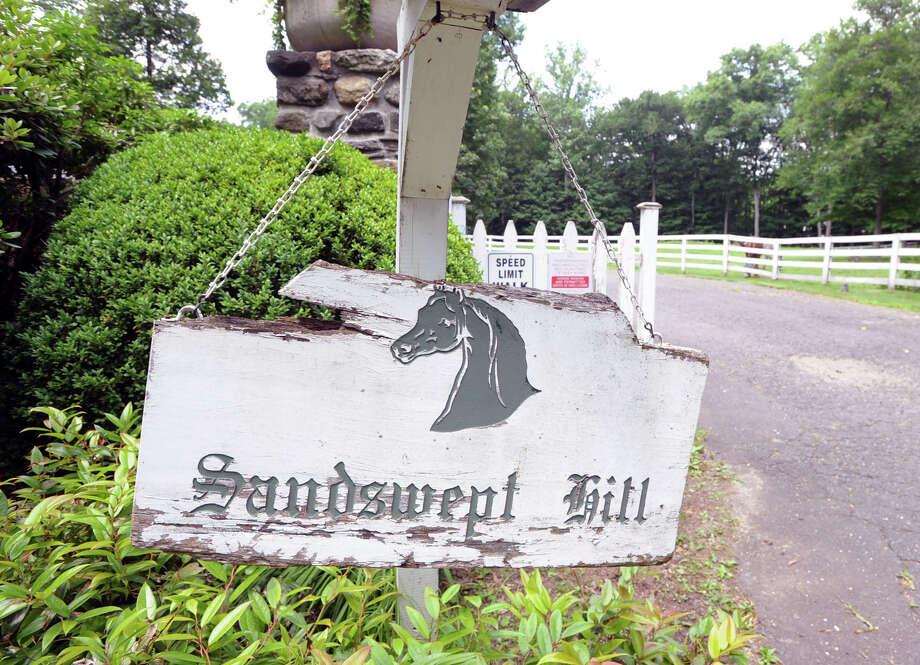 """Sandswept Hill"" reads the sign at the entrance to the 25.3 acre property that is for sale with an asking price of $13,900,000 at 50 Lafrentz Rd., Greenwich, Conn., Wednesday, June 25, 2014. Photo: Bob Luckey / Greenwich Time"