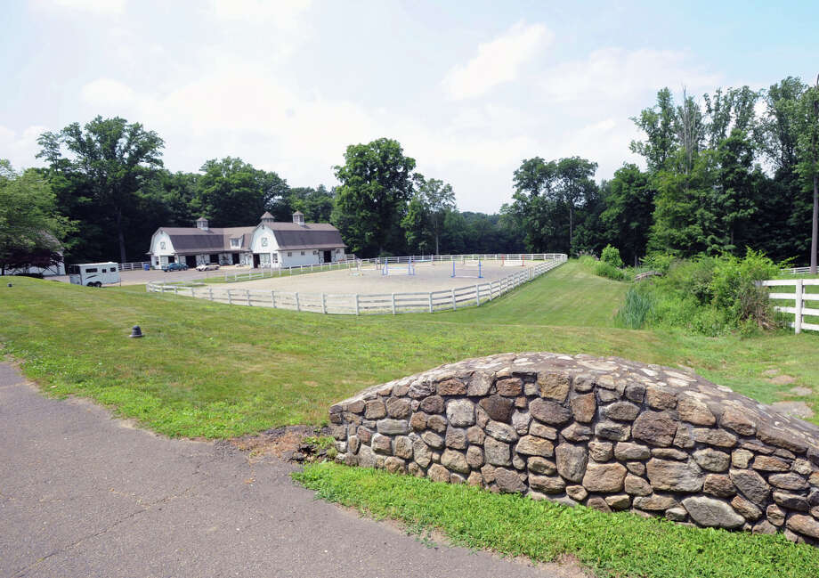 A riding ring, barn and stone wall are visible on the 25.3 acre property that is for sale with an asking price of $13,900,000 at 50 Lafrentz Rd., Greenwich, Conn., Wednesday, June 25, 2014. Photo: Bob Luckey / Greenwich Time