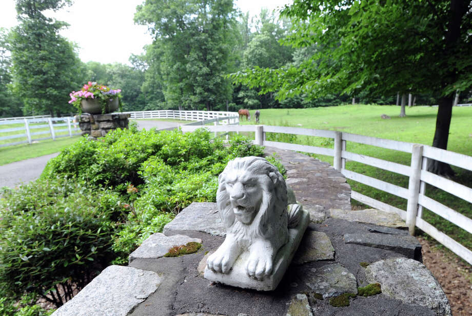 A stone lion at the entrance to the 25.3 acre property that is for sale with an asking price of $13,900,000 at 50 Lafrentz Rd., Greenwich, Conn., Wednesday, June 25, 2014. Photo: Bob Luckey / Greenwich Time