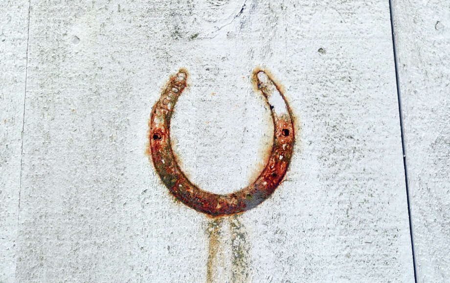 The imprint of a rusted horseshoe is visible on the exterior wall of the main barn on the 25.3 acre property that is for sale with an asking price of $13,900,000 at 50 Lafrentz Rd., Greenwich, Conn., Wednesday, June 25, 2014. Photo: Bob Luckey / Greenwich Time