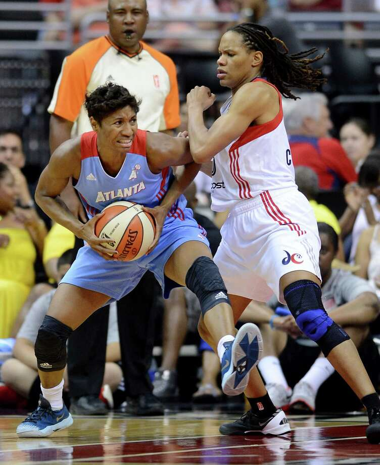 WNBA All-Star Angel McCoughtry (left)  Photo: Chuck Myers, McClatchy-Tribune News Service / MCT