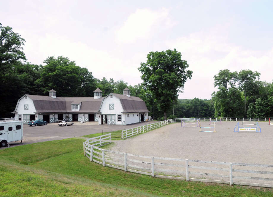 A barn and a riding ring on the 25.3 acre property that is for sale with an asking price of $13,900,000 at 50 Lafrentz Rd., Greenwich, Conn., Wednesday, June 25, 2014. Photo: Bob Luckey / Greenwich Time
