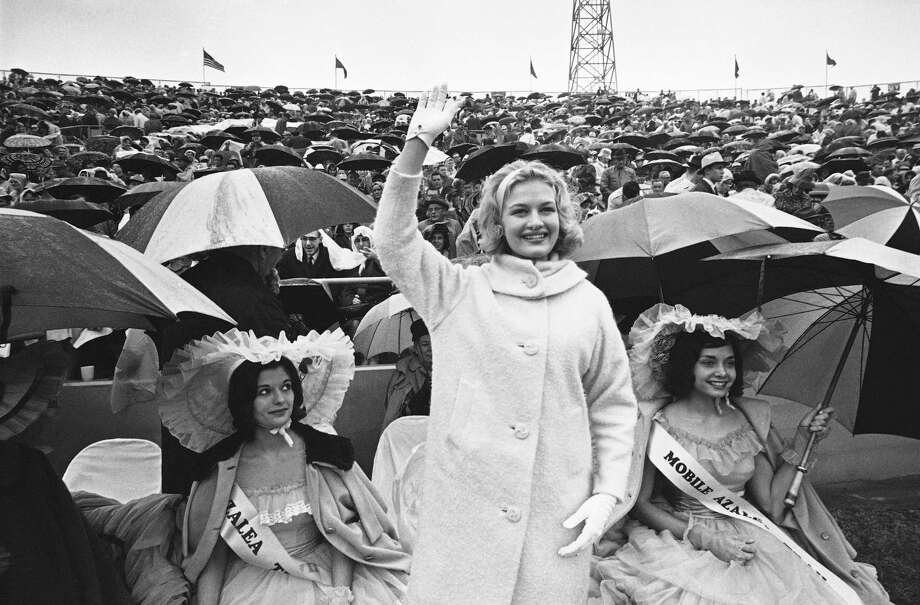 """Diane Sawyer does a beauty queen wave as """"America's Junior Miss"""" on Jan. 4, 1964, at the """"Senior Bowl"""" game in Mobile, Alabama. Photo: Jim Bourdier, AP / AP1964"""
