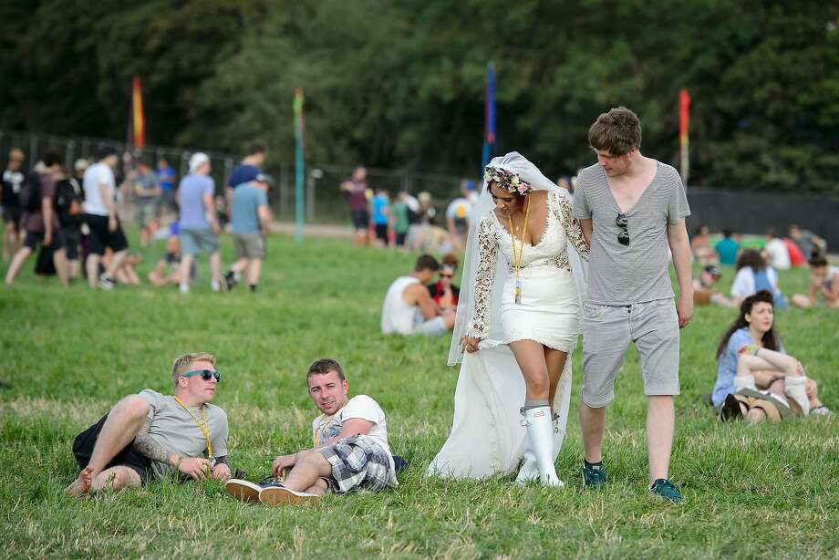 First comes love, then comes marriage, then comes heavy metal:Newlyweds Jack and Bianca Vaughan arrive at the Glastonbury Festival of Music and Performing Arts in Somerset, England, after their wedding ceremony. Headliner for this year's concert weekend is the Bay Area's own Metallica. Photo: Leon Neal, AFP/Getty Images