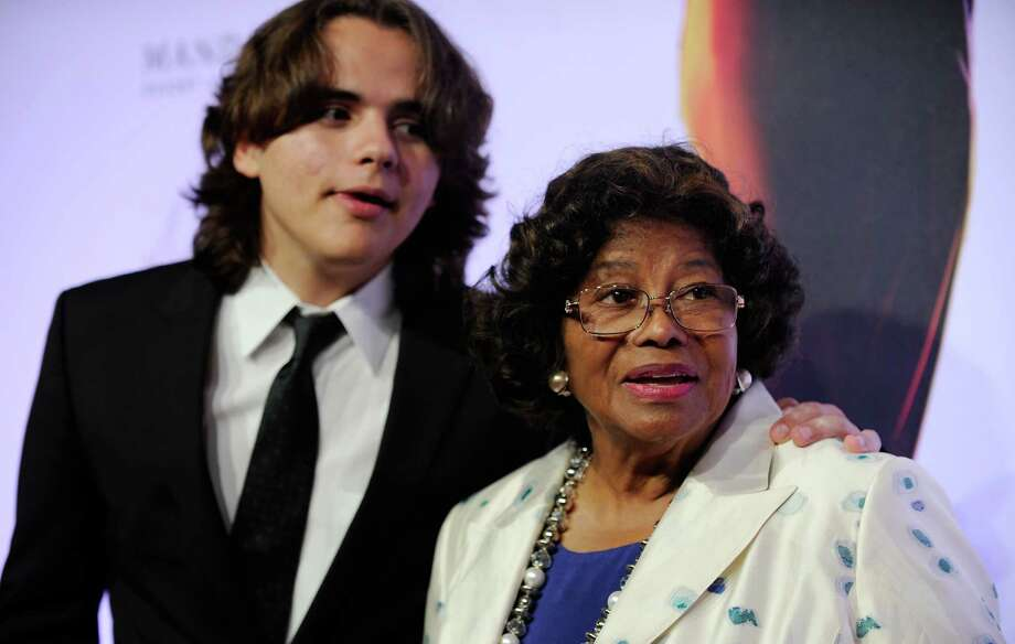 "FILE - In this June 29, 2013 file photo, Prince Jackson, left, and Katherine Jackson arrive at the world premiere of ""Michael Jackson ONE"" at THEhotel at Mandalay Bay Resort and Casino in Las Vegas. Jackson's 2002 will calls for his estate to support his mother, Katherine, and his three children, while leaving nothing for his siblings and his father. Through the end of 2012, Jackson's estate paid nearly $20 million to support his mother and children. (Photo by David Becker/Invision/AP, File) Photo: David Becker, David Becker/Invision/AP / Invision"