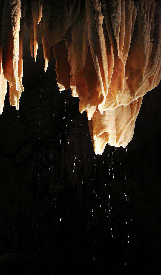 Metro daily - Water drips from a cave formation at Natural Bridge Caverns due to recent rains.  The caves are in the Glen Rose Aquifer which is part of the Trinity Aquifer Group.  Friday, July 13, 2007.  Photo Bob OWen Photo: Bob Owen, SAN ANTONIO EXPRESS-NEWS / SAN ANTONIO EXPRESS-NEWS