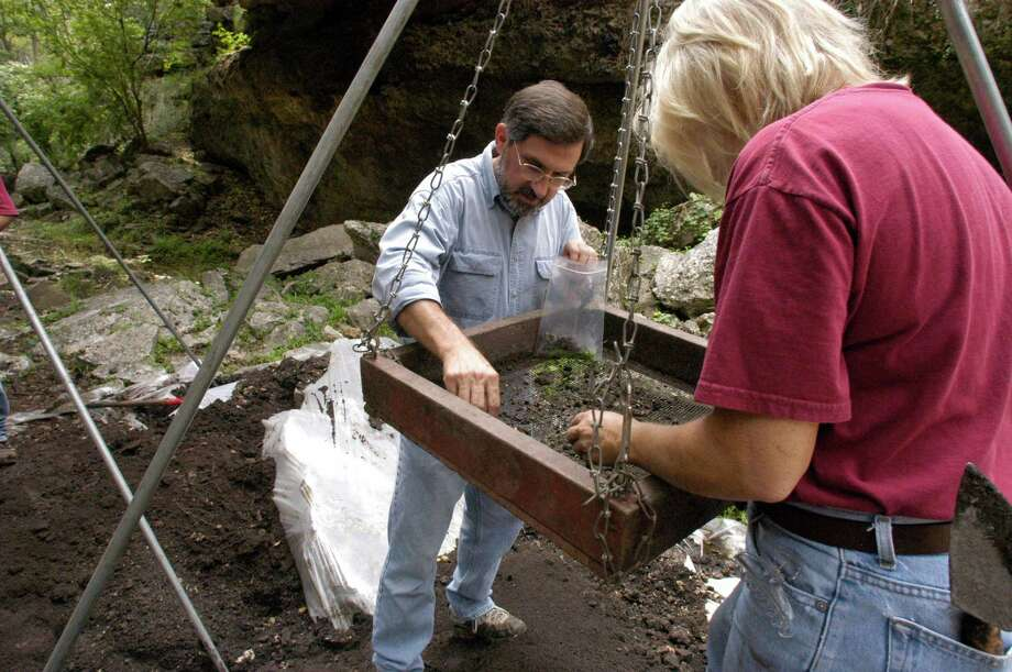 "UTSA researchers Dr. Steve Tomka (background) and Donna Bixby are working (Screening) on a archeolgical dig for the first time in the history at the Natural Bridge Caverns located on FM 3009 in Comal County between San Antonio and New Brraunfels. 09/24/2003.  (E. Joe Deering/Chronicle).  HOUCHRON CAPTION  (09/27/2003): Researchers Steve Tomka, left, director of the University of Texas at San Antonio's Center for Archaeological Research, and Donna Bixby sift for artifacts at an archaeological dig at Natural Bridge Caverns. Tomka was asked to do the investigation by the owners, the Wuest family, who want to clear up some of the ""mysteries"" surrounding the landmark.  HOUCHRON CAPTION (09/27/2003-2-STAR): Researchers Steve Tomka, left, director of the University of Texas at San Antonio's Center for Archaeological Research, and Donna Bixby sift for artifacts at an archaeological dig at Natural Bridge Caverns, located between San Antonio and New Braunfels.  Tomka was asked to do the investigation by the owners, the Wuest family, who want to clear up some of the ""mysteries"" surrounding the landmark. Photo: E. Joseph Deering, Houston Chronicle / Houston Chronicle"