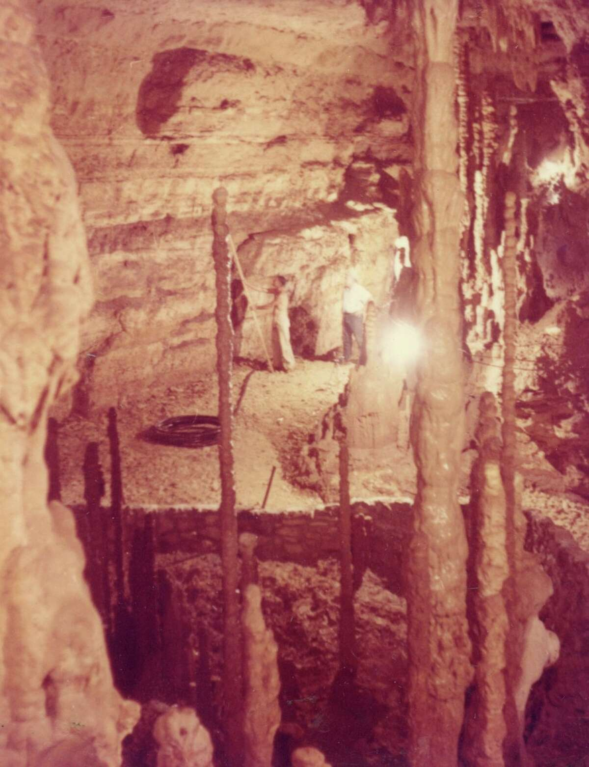 1963-64: Development related excavations took place at the caverns to enlarge the entrance, provide a walkway and develop a trail system inside the cavern. During excavation of the entrance trail, a human tooth, arrowheads, and spearheads dating from 5,000 BC were found.