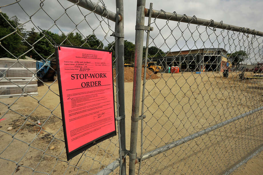 United Wall Systems, of Fitchburg, Mass., was issued a stop-work order at the construction site of the new CVS store at 969 High Ridge Road in Stamford, Conn., by the state Department of Labor on Wednesday, June 25, 2014, because of the company's alleged failure to obtain adequate workers' compensation coverage for their employees. Photo: Jason Rearick / Stamford Advocate