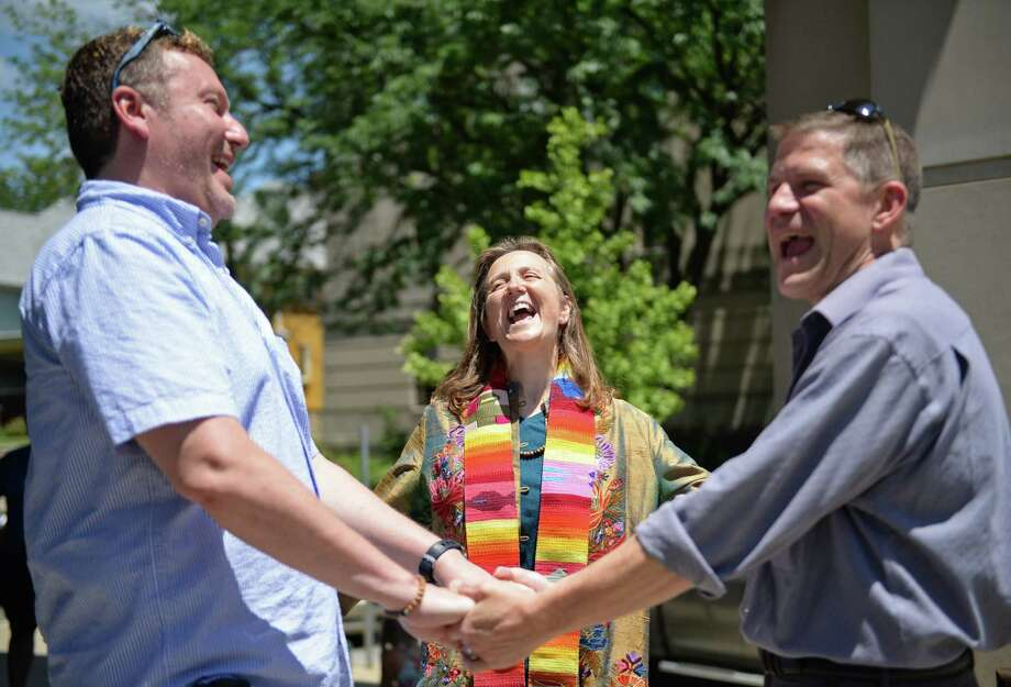 The Rev. Mary Ann Macklin, center, officiates the wedding ceremony for Jeff Jewel, left, and Jeff Polling, who have been together for 18 years, on the steps of the Monroe County Justice Building in Bloomington, Ind. Photo: Chris Howell, MBO / Bloomington Herald-Times