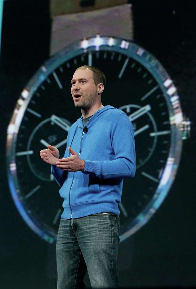 David Singleton, Android director of engineering, speaks about Android Wear at the Google I/O 2014 keynote presentation in San Francisco, Wednesday, June 25, 2014. As the Internet giant's Android operating system stretches into cars, homes and smartwatches, this year's annual confab will expand on its usual focus on smartphones and tablets. (AP Photo/Jeff Chiu) ORG XMIT: CAJC112 Photo: Jeff Chiu / AP