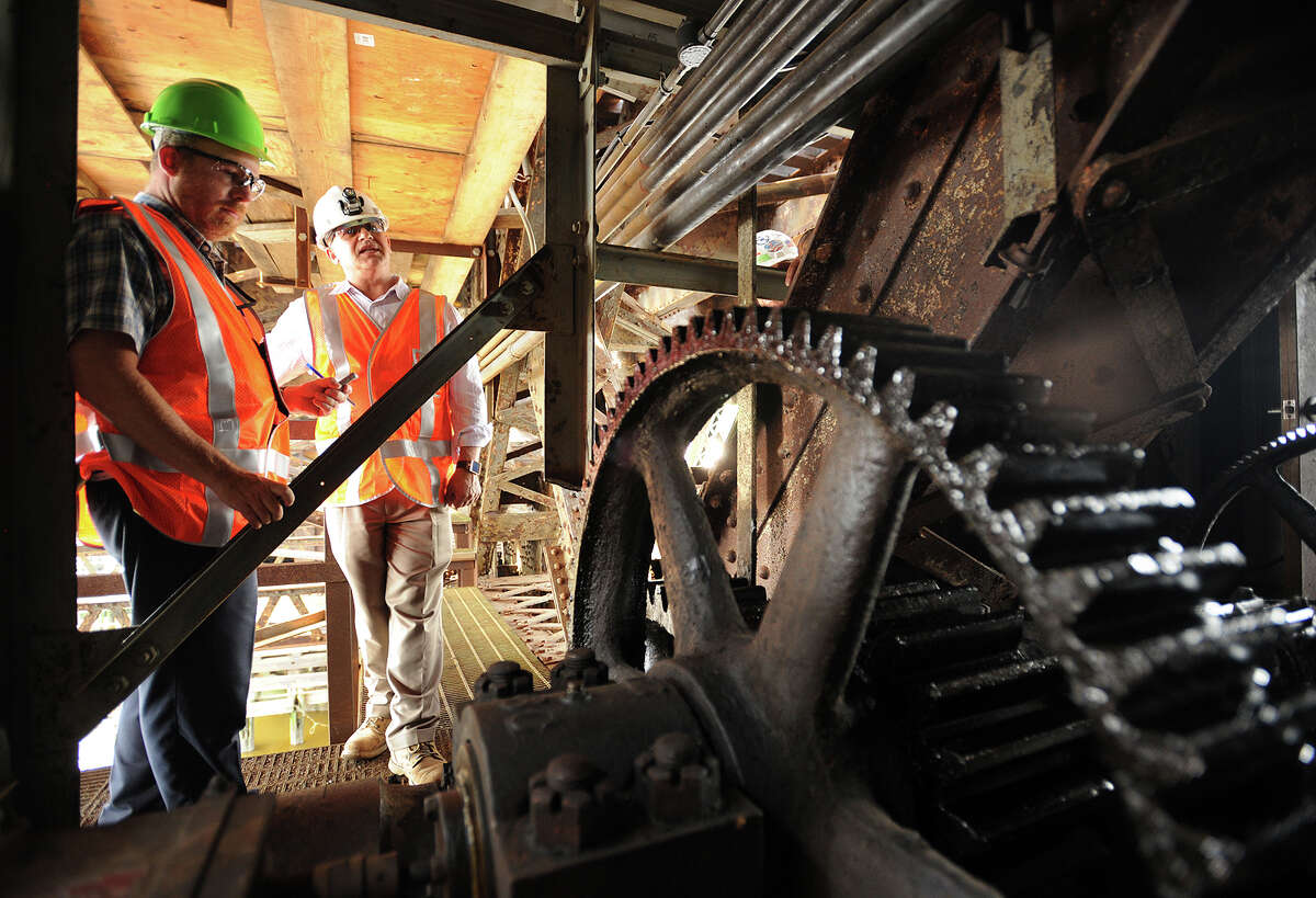 Deputy Director of Structures Leon Kagan, right, shows the gears which failed, causing halts to train traffic on the Walk Bridge, the train bridge crossing the Norwalk River in Norwalk, Conn. on Wednesday, June 25, 2014.