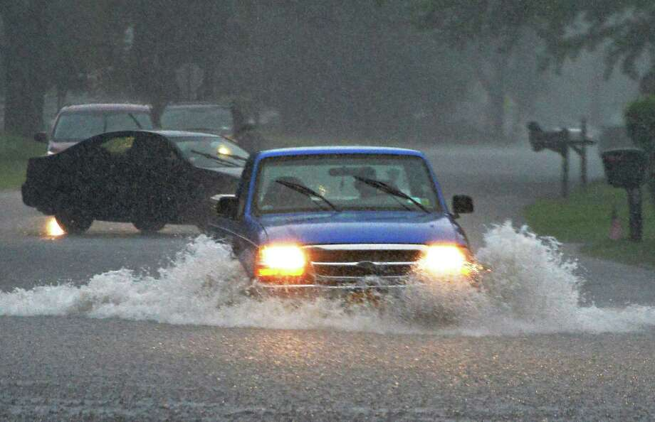 Traffic navigates a flooded portion of South Barney Road during heavy rains Wednesday June 25, 2014, in Clifton Park, NY. (John Carl D'Annibale / Times Union) Photo: John Carl D'Annibale / 00027510A